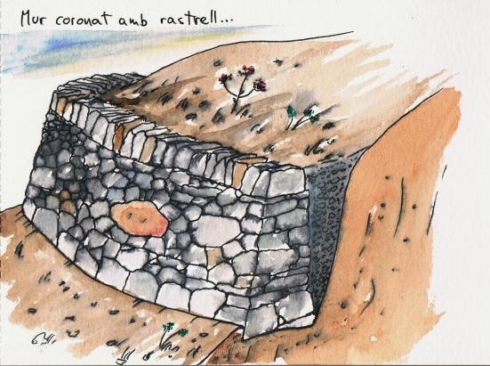mur pedra seca coronat amb rastrell
